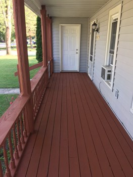 Front porch just has been freshly stained.and is the perfect place to start or end you day. (photo 2)