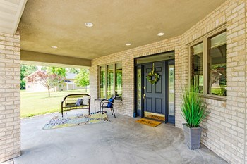 This quaint covered porch is the perfect place to welcome guests or just sit and relax. (photo 2)