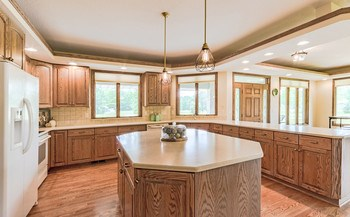 This custom kitchen by LeBeau has been carefully designed with function and style in mind. Enjoy the ease of prep and serving with the ample storage space and counters that seem to go on for miles! (photo 3)