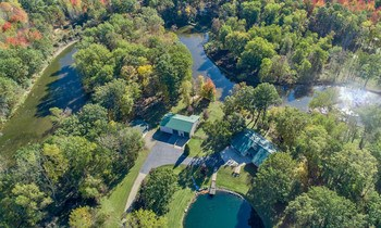 Situated on 9.9 acres this property features the perfect mix of mature woods, open green space, private pond and almost 2000 ft of river frontage, this home and property is sure to take your breath away! (photo 2)