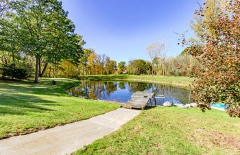 Enjoy quiet time relaxing by your private pond stocked that includes small mouth bass, rainbow trout, panfish and catfish to name a few. Or head to the back of the property and launch your boat right into to the river. (photo 4)