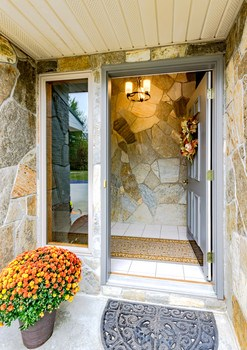 Beautiful stone welcomes you up the entryway and carries into the foyer of the home. (photo 5)