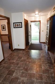 The front entry is very spacious.  The perfect spot for welcoming your family and friends into your home.  There is a large coat closet and this area open into just about every room on the main floor. (photo 2)