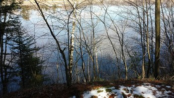 Sanford Lake---1.56 acres with approx 150' of waterfront. City water and natural gas are at the road. Pull in the driveway and walk the trail to the water---- (photo 1)