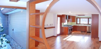 Lovely entryway with hand crafted architectural element between the foyer and open gourmet kitchen. (photo 5)