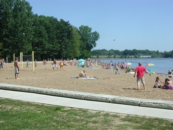 Sanford Lake Park: Located on beautiful Sanford Lake the park is open Sunday - Saturday from 7:00 AM - 9:00 PM.  It's staffed by Midland County personal.  It includes a large boat launch, sandy beach, swimming area, volleyball court, horseshoe pits, playground equipment, spray pad, pavilions, picnic tables, grills, modern restrooms, entry fee, etc. (photo 3)