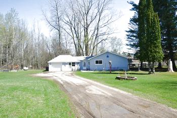 2 bedroom ranch with plenty to offer!  This home has been very nicely taken care of.  It has newer vinyl siding, roof and many other updates already completed.  The floor plan has a nice flow with the oversized rooms.  The 2.4 acres of land also contain a second driveway that is ready for a second home with electrical well & septic all available.  Call today for more information. (photo 1)