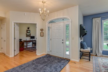 Warm and inviting entrance with new lighting and wood flooring (photo 5)