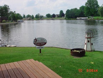 THAT is a view!   You won't miss any of the action coming or going on Heron Cove.   The water is 5-6 feet deep. Wixom Lake is 1980 square acres+.   It's deepest points are 40 feet. The fishing is Great! (photo 3)