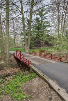 Driveway with a charming bridge will welcome you home. (photo 2)