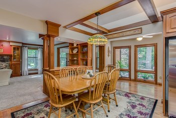 Ample casual dining space for the entire family - you can view the backyard from here through many gorgeous windows that face the park-like setting. (photo 5)