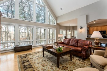 The large, plentiful windows allow for a sun filled room and is the perfect place to relax in comfort. (photo 2)