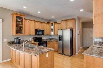 Exquisite granite counter-tops and spotless appliances accompany the kitchen. (photo 4)