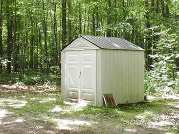 Small storage shed included. (photo 2)