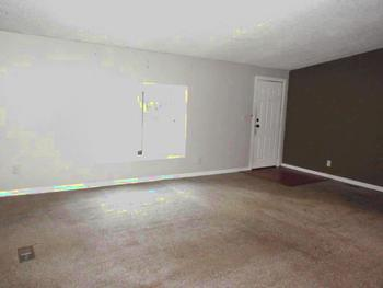 Large living room located in the front of the home. New Carpet is being installed. (photo 3)