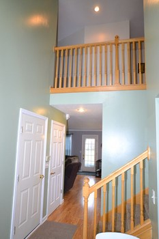 Upon entering you are welcomed into a two story entry.  There is a banister along the second floor hallway to open the floor plan.  This space also allows you easy access to the 3 car garage and any living space on the main level. (photo 4)