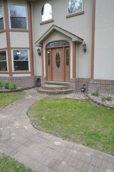 The home has paver walkways leading to the front entrance and around the home.  Impressive statement for family and friends visiting. (photo 4)