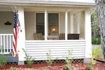 12 X 8 Screened in Porch is located in the front of the home, Wonderful for relaxing & enjoying the scenery after a long work day. (photo 3)