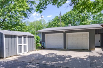 Two plus car attached garage, and extra shed. (photo 4)
