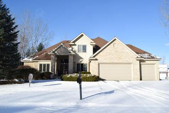 Impeccable  Quality built home.  You will be proud to call this 4 bedroom home your own.  It has a brick exterior with a two story entry, many built ins and upgrades.  The main floor is completed with Maple flooring and their is plenty of windows for  natural light to flow in.  The kitchen is a chefs delight with plenty of cabinets and a large island.  The finished basement also adds a huge amount of living space.  The floor plan boast a main floor master , formal dining and large den.  Plenty of space to spread out for any size family.  Located in a newer subdivision with impressive styled homes.  Call today to make your personal showing appointment. (photo 1)