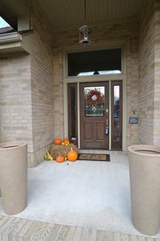 The grand covered front porch makes a great first impression. (photo 3)