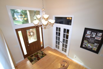 Once inside the home the front entry open into the spacious living spaces.  The two story entry has transom windows that allow plenty of natural light into the space. (photo 4)