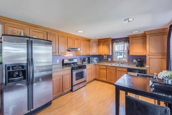 The kitchen is nicely updated featuring stainless appliances and oak cabinets. (photo 4)