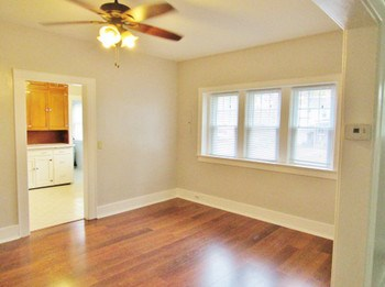 The dining room has new vinyl flooring with the look of hardwood along with plenty of windows and enough space for a large table to entertain family and friends. (photo 4)