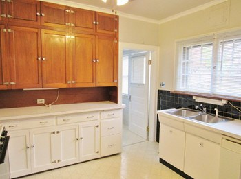 The kitchen has charm and character everywhere you look. From the ceramic tile, the original cabinets and sink. Plenty of counter space and abundant cabinet space. (photo 5)