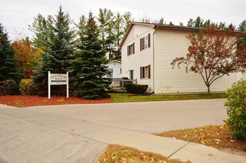 Terrific townhouse apartment near Northwood University. Two bedrooms, 1.5 baths with washer/dryer in basement. Kitchen has stove, refrigerator, built-in microwave, garbage disposal and deck with privacy! (photo 1)