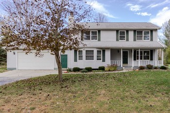 Wonderful Family Home Setting on 3.09 Acres in Larkin Township with a Large Double Pole Barn! Many Beautiful Updates, New Kitchen with Granite Counter Tops, Stainless Steel Appliances & Updated Ceramic Tile Floors. Dinning Rm/Den & Living Rm with New Wood Floors & Gas Fireplace.  Bathrooms Updated with Granite & a 3rd Bath was Added Downstairs, 4th Bedroom is downstairs with an Egress Window.  The Property is Surrounded by Woods for Added Privacy. City Water & Natural Gas. Water Assessment is paid. (photo 1)