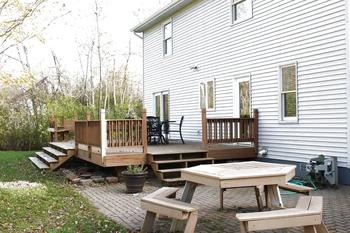 Large wood deck with seating & Brick Paver Patio (photo 4)