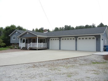 Expansive driveway with 3+ car Amish-built garage!  The attic area has tons of storage also. (photo 2)