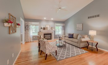 Let the sun shine in during the daytime from the living room's large windows , or relax by the beautiful fireplace as the evening sets in. Rich wood floors flow throughout the main floor. (photo 2)
