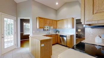 The large kitchen connects to the living room, formal dining room and the garage entry, where you'll find the powder room, laundry/mudroom, and pantry. (photo 4)