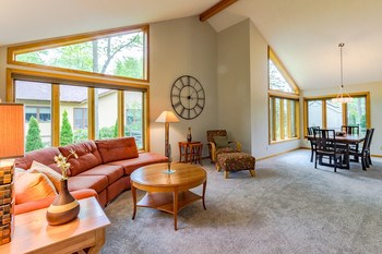 This view! Your eye will be drawn to the beautiful views from the wall of windows in the spacious living and dining room. (photo 2)