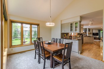 Vaulted ceilings in the living and dining room add dimension to the open floor plan that runs from the kitchen thru the dining and living areas making this home the perfect setting for entertaining. (photo 3)