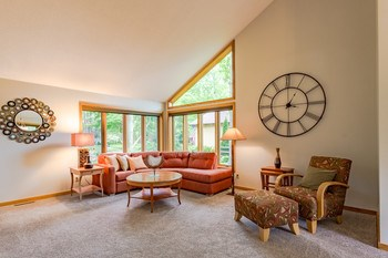 This inviting living room features brand new carpet and lots of natural light! (photo 4)