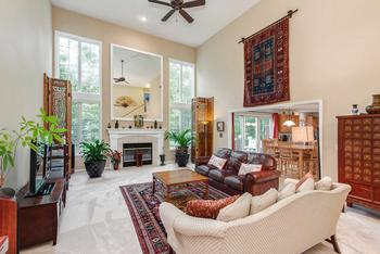 Stunning Great Room for entertaining and living!  Grand windows for natural daylight and the highlight over the gas-log fireplace is the custom mirror (photo 2)