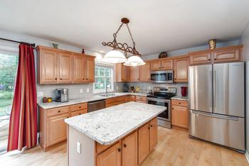 The kitchen just had a makeover - it's ready for you to enjoy with the entire family - New granite tops & tile backsplash, fresh paint, new stainless sink and faucet - all stainless steel appliances and range was just installed in June of this year. (photo 5)