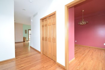 The large foyer is open to a balcony above. (photo 3)