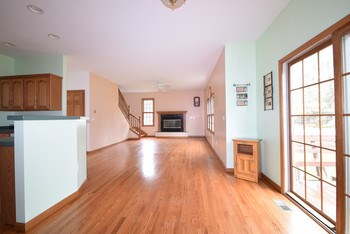The family room overlooks the back yard and is open to the eat-in kitchen.  Newer hardwood floors through the kitchen, family room and dining room. (photo 5)