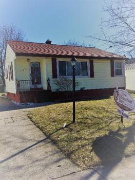 Very warm and cozy two bedroom home located in the city of Essexville, move in ready with neutral colors.  Home features large rooms, newer windows , 5 year old roof, partially finished basement , fenced yard with shed.  This home offers plenty of storage.  Why rent when you can own for less.