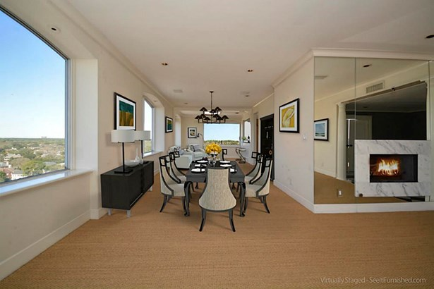 Open dining area with a gas fireplace as virtually depicted here. (photo 3)