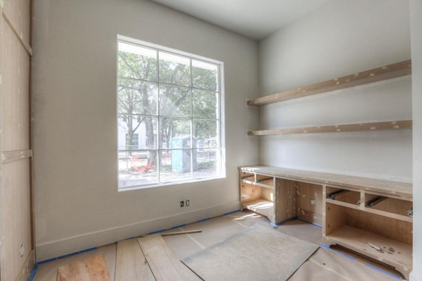 Just off of the reception hall is the quaint study that will be accessed through solid double doors keeping noise level to a minimum when working from home. 12 pane wood frame windows carry natural light into this space making it light and airy. (photo 3)