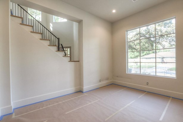 """Dining room positioned just past the foyer is flooded with natural light through the western exposure wood frame Marvin Integrity windows. 5"""" select White Oak hardwoods are complimented by 8 inch baseboards and crown molding. Construction as of 6/10 (photo 4)"""