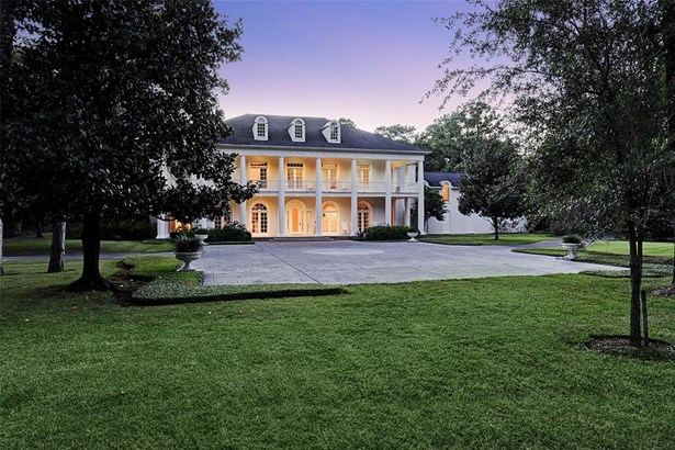 Gracious Southern Colonial style 14,094 sf home with front porch and balcony built originally by an international hotelier.