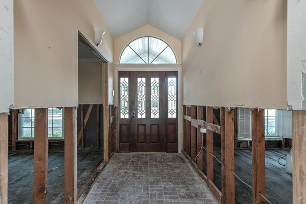 Entry makes a grand statement with brick flooring and arched window over the handsome door, providing abundant natural light. (photo 3)