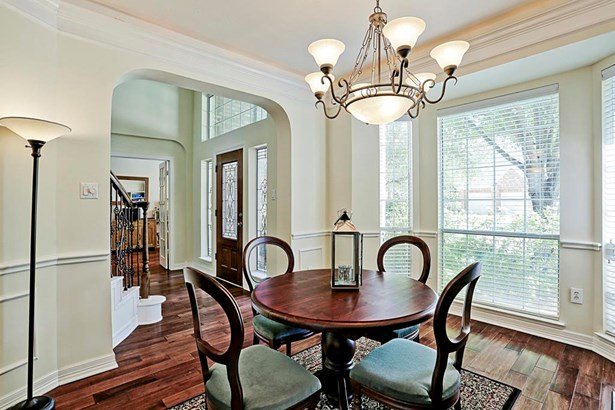 The formal dining room has arched doorways, crown molding and generous amounts of natural light. (photo 3)