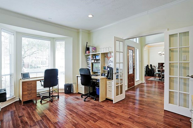 The study is directly off of the entry and has recessed lighting, crown molding, French doors and is pre-wired for stereo speakers. The bay window brings in natural light. If desired, this room could also be used as a formal living room. (photo 4)